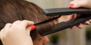 hair straightener on hair